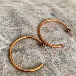Half  hoop earrings quarter size